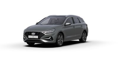 Front side view of the new Hyundai i30 Wagon in the colour Olivine Grey.