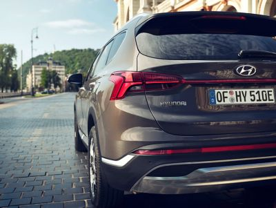 The new Hyundai SANTA FE Plug-in Hybrid 7 seat SUV showing its new taillight design.